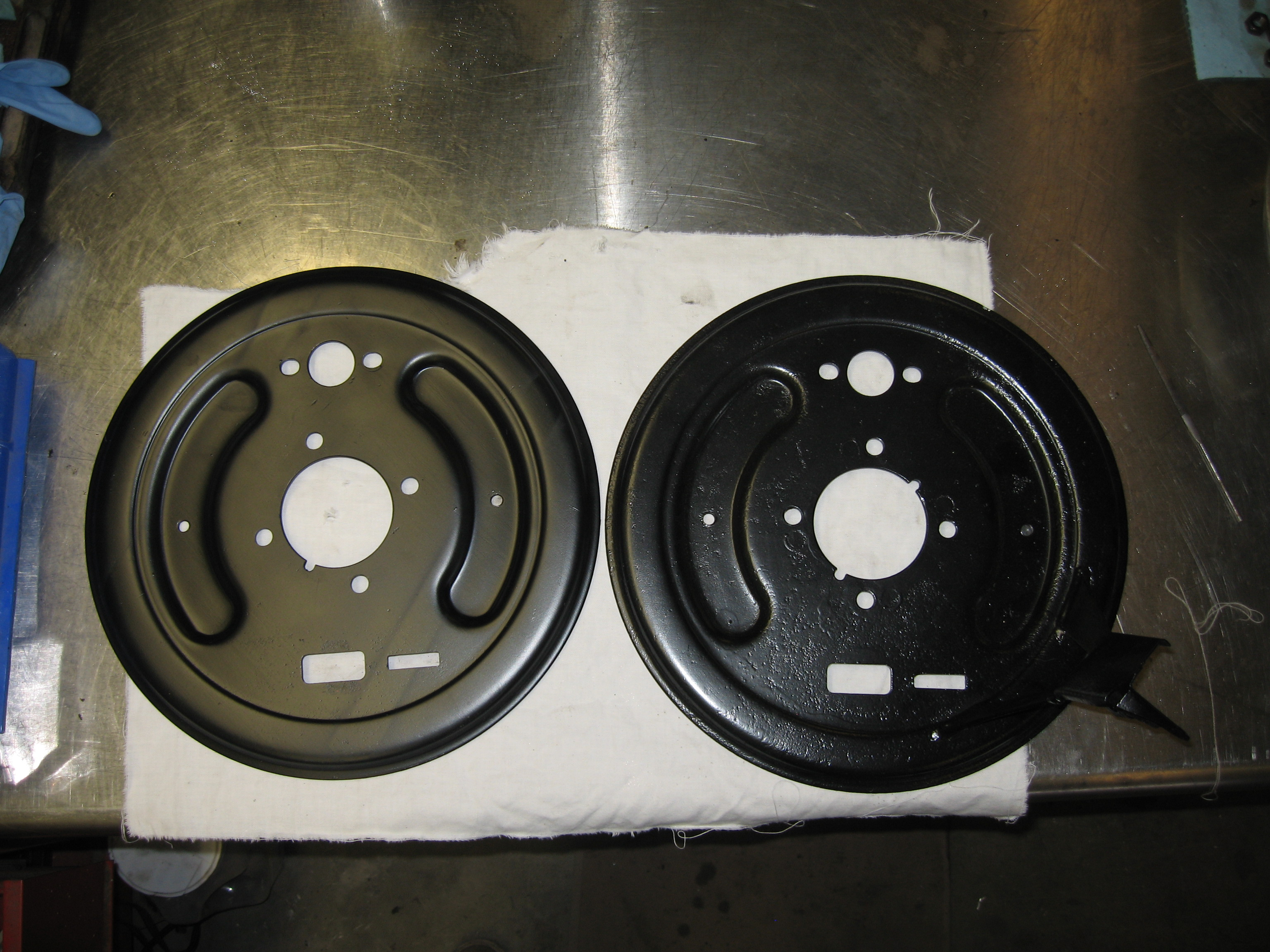 The plate on the left is a standard Giulietta part and the plate on the  right is the modified Veloce part.